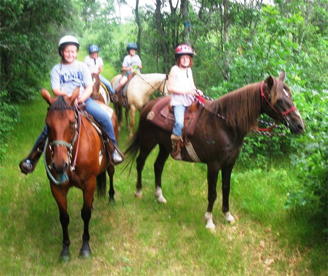 Day campers on a trail ride.